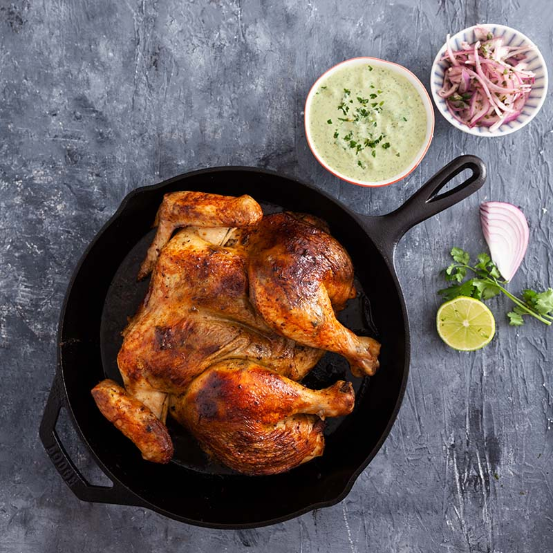 Peruvian-Style Chicken with Spicy Green Mayonnaise and Pickled Onions